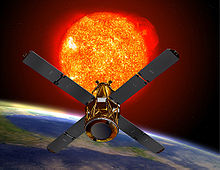 An artists depiction of the RHESSI spacecraft observing the sun